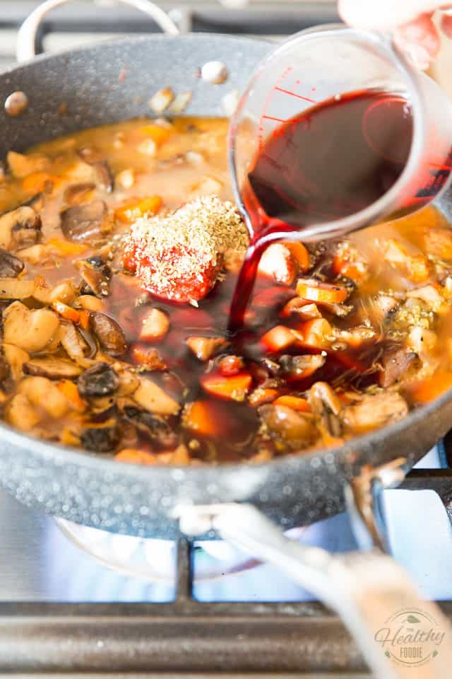 Add the vegetable stock and red wine to the pan