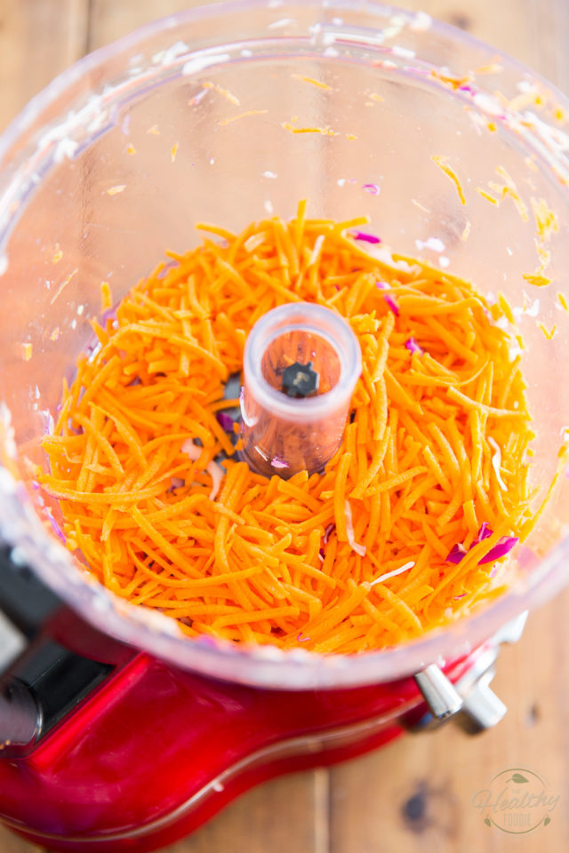 Grate the carrots, with a box grater or food processor