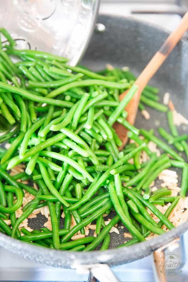 Add the green beans, stir to coat well