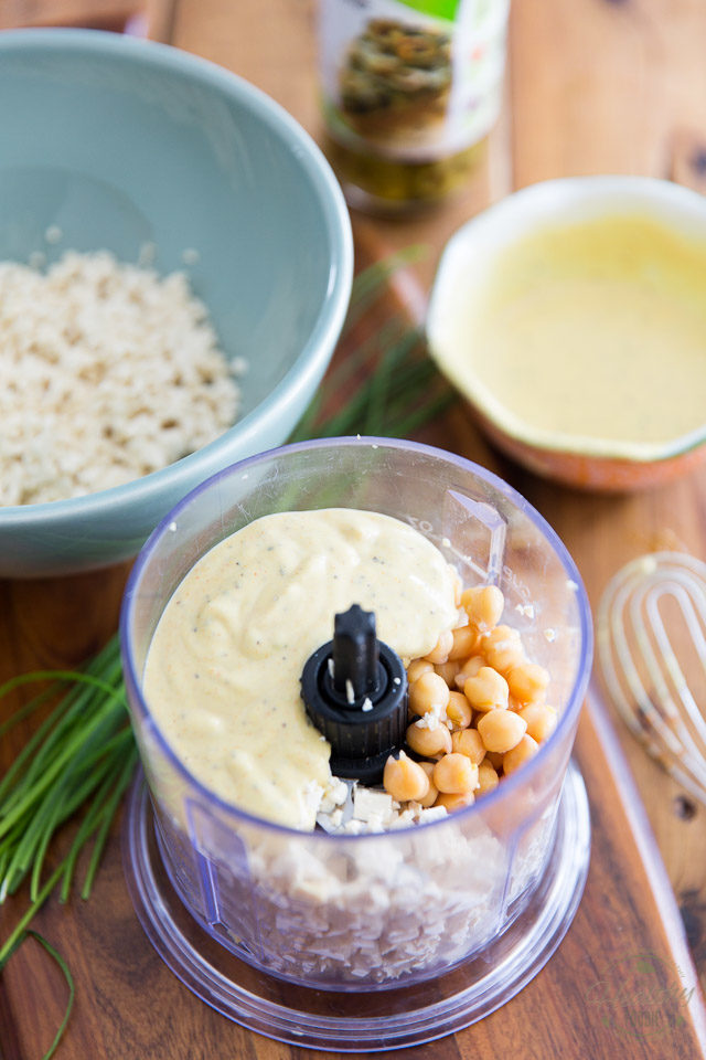 Pour half the dressing into the food processor with half the chopped tofu and chickpeas