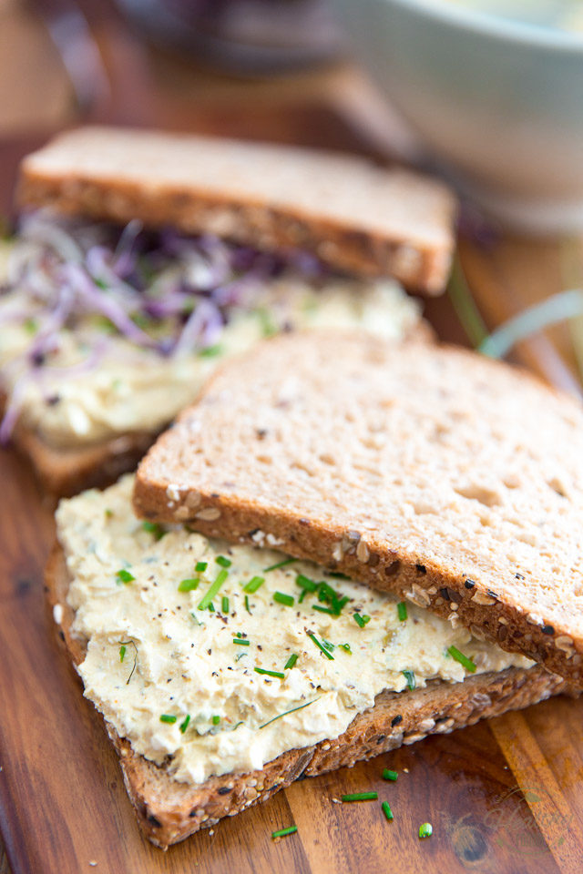 Garnish with chopped chives and top with a second slice of bread
