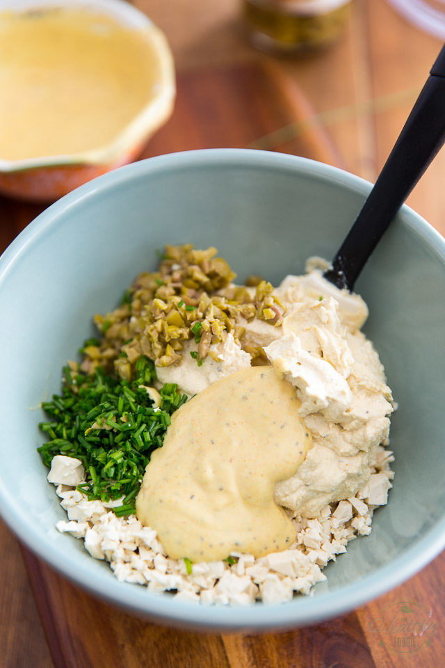 Add the creamy mixture, the rest of the dressing to the bowl with the chopped tofu