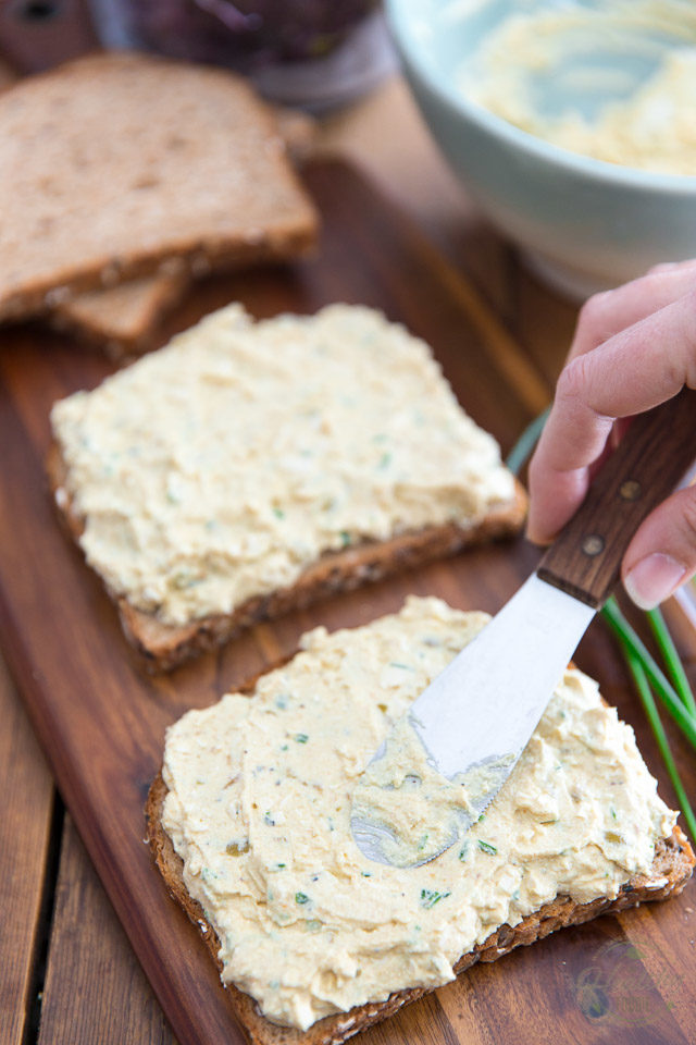 Spread the egg salad onto 4 slices of bread