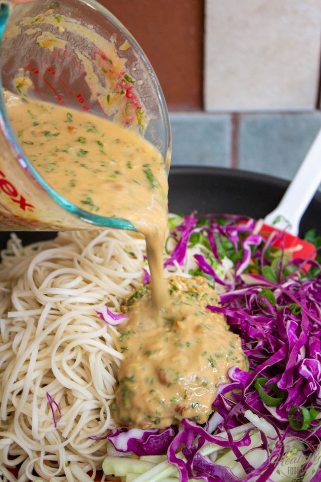 Pouring the peanut sauce right into the pan